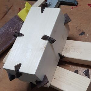 Inserted dark wood miter splines